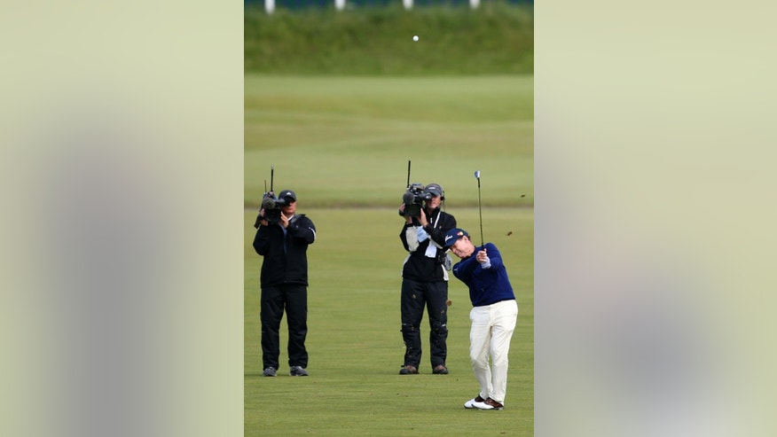 United States' Tom Watson plays his second shot from the first fairway during a special Champion Golfers' challenge at the British Open Golf Championship at the Old Course, St. Andrews, Scotland, Wednesday, July 15, 2015. (AP Photo/Peter Morrison)