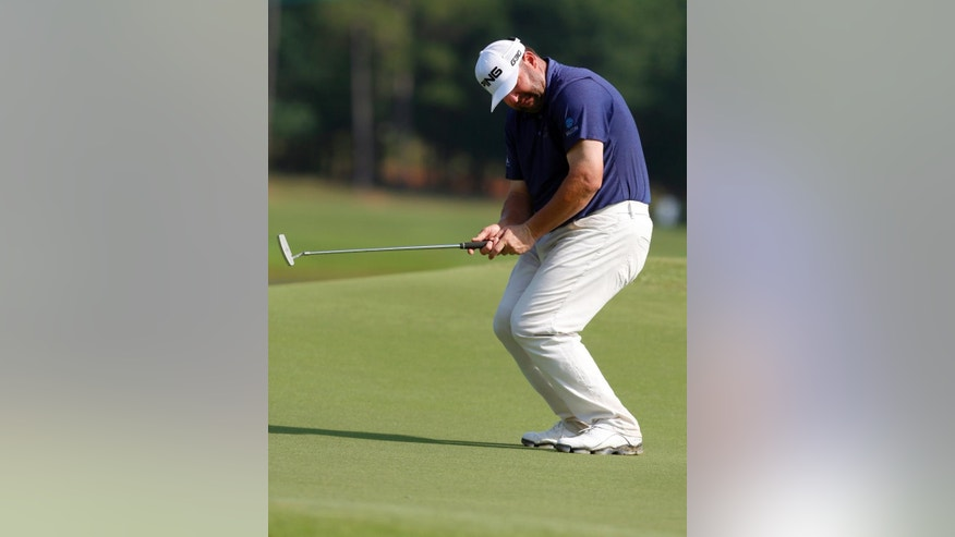 Jason Gore reacts to missing a birdie putt on the 17th hole during the first round of the Barbasol Championship golf tournament Thursday, July 16, 2015, in Opelika, Ala. (AP Photo/Butch Dill)