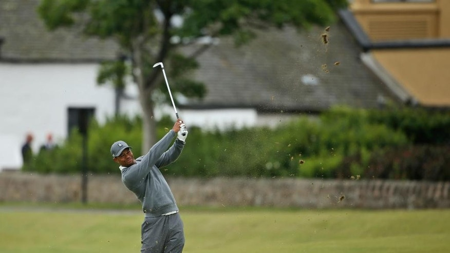 United States' Tiger Woods plays a ball on the third fairway during the first round of the British Open Golf Championship at the Old Course, St. Andrews, Scotland, Thursday, July 16, 2015. (AP Photo/Peter Morrison)