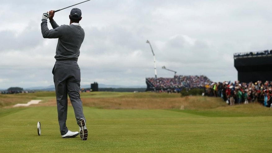 United States' Tiger Woods tees off from the seventh hole during the first round of the British Open Golf Championship at the Old Course, St. Andrews, Scotland, Thursday, July 16, 2015. (AP Photo/Peter Morrison)