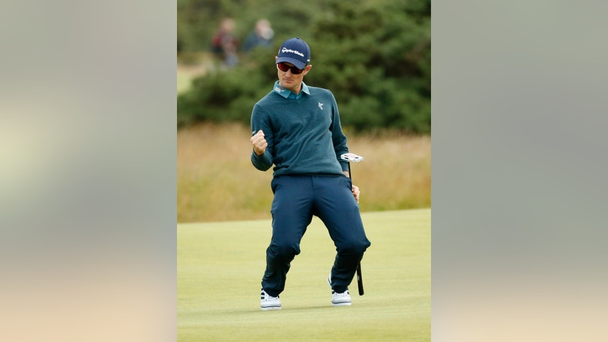 England's Justin Rose reacts after a birdie on the fourth green during the first round of the British Open Golf Championship at the Old Course, St. Andrews, Scotland, Thursday, July 16, 2015. (AP Photo/Jon Super)