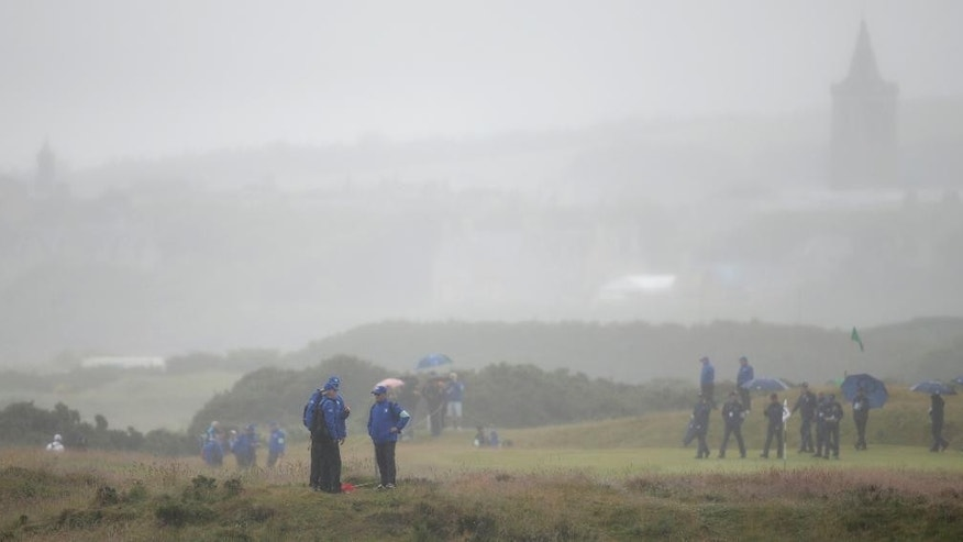 Marshals stand in the rough on the sixth hole during a practice round at the British Open Golf Championship at the Old Course, St. Andrews, Scotland, Wednesday, July 15, 2015. (AP Photo/Alastair Grant)