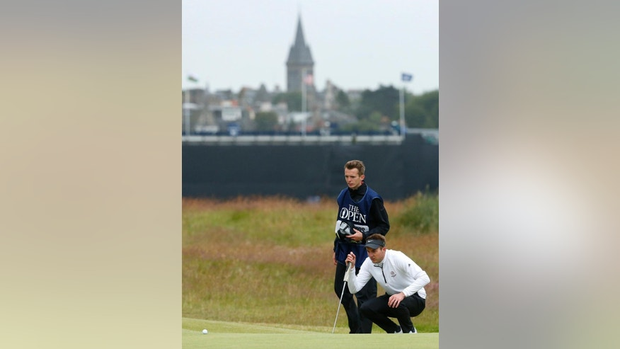 England's Ashley Chesters lines up a putt on the 16th green during the first round of the British Open Golf Championship at the Old Course, St. Andrews, Scotland, Thursday, July 16, 2015. (AP Photo/Jon Super)