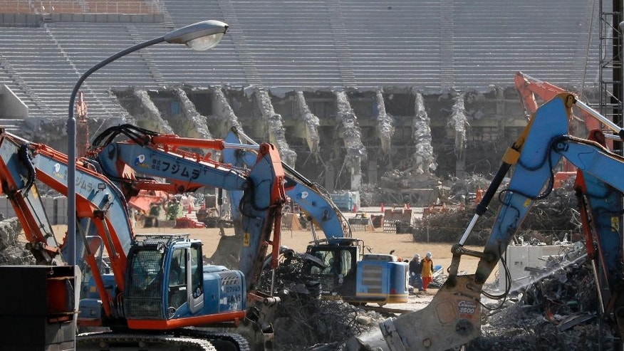 FILE - In this March 5, 2015 file photo, Japan's National Stadium is dismantled for the renovation for the 2020 Tokyo Olympic Games, in Tokyo. When the dust settles on the marquee venue for the 2020 Summer Olympics in Tokyo, it could well be the most expensive sports stadium in the world.Now, Tokyo's planned National Stadium for the 2020 Olympics will be the first to reach $2 billion, according to the latest cost estimate. (AP Photo/Shuji Kajiyama, File)