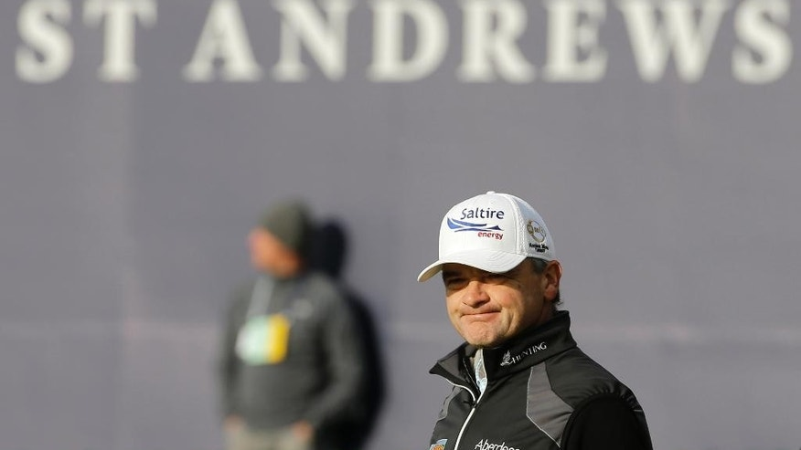 Scotland's Paul Lawrie stands on the 18th hole after finishing the second round of the British Open Golf Championship at the Old Course, St. Andrews, Scotland, Saturday, July 18, 2015. (AP Photo/David J. Phillip)