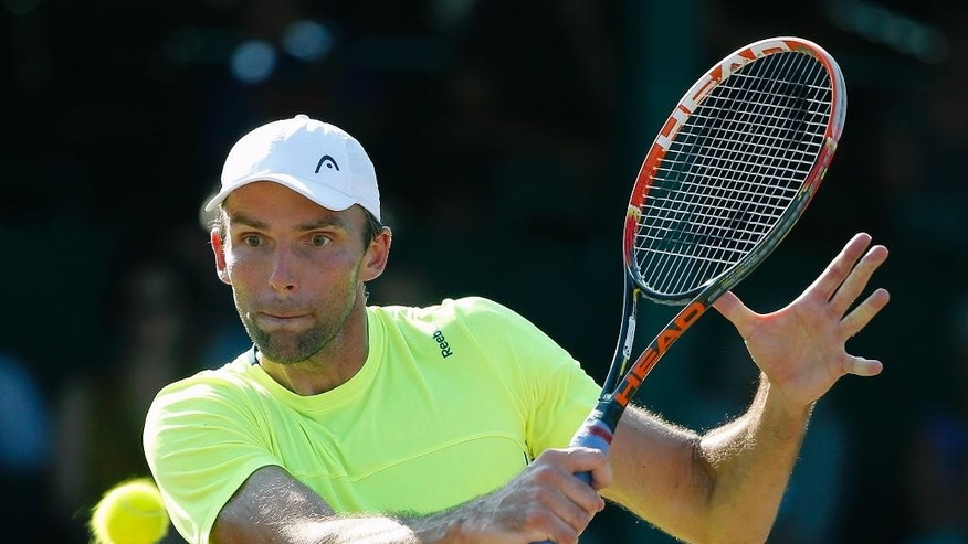 Ivo Karlovic, of Croatia, plays against Jack Sock during a Tennis Hall of Fame Championship semifinal match in Newport, R.I., Saturday, July 18, 2015. (AP Photo/Michael Dwyer)