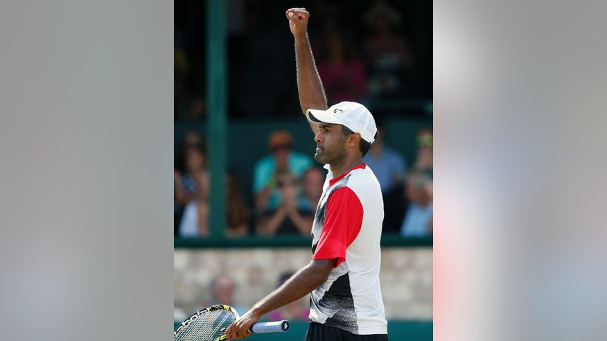 Rajeev Ram celebrates after defeating John-Patrick Smith, of Australia, in a Tennis Hall of Fame Championship semifinal match in Newport, R.I., Saturday, July 18, 2015. (AP Photo/Michael Dwyer)