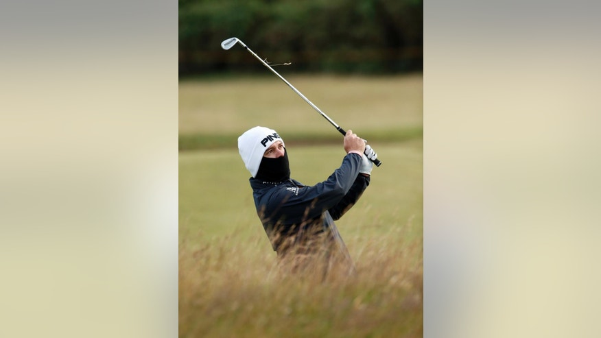 South Africa' Louis Oosthuizen plays a shot on the 13th hole during the second round of the British Open Golf Championship at the Old Course, St. Andrews, Scotland, Saturday, July 18, 2015. (AP Photo/Jon Super)