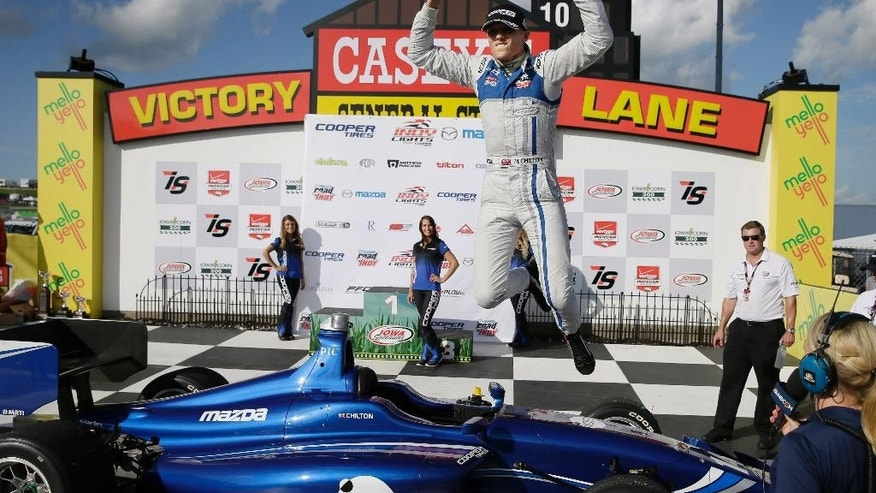 Max Chilton leaps in Victory Lane after winning the Indy Lights Series auto race Saturday, July 18, 2015, at Iowa Speedway in Newton, Iowa. (AP Photo/Charlie Neibergall)