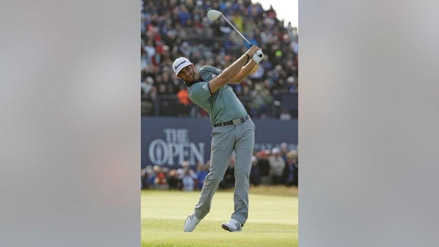 United States' Dustin Johnson drives a ball  from the 18th tee during the second round of the British Open Golf Championship at the Old Course, St. Andrews, Scotland, Saturday, July 18, 2015. (AP Photo/David J. Phillip)