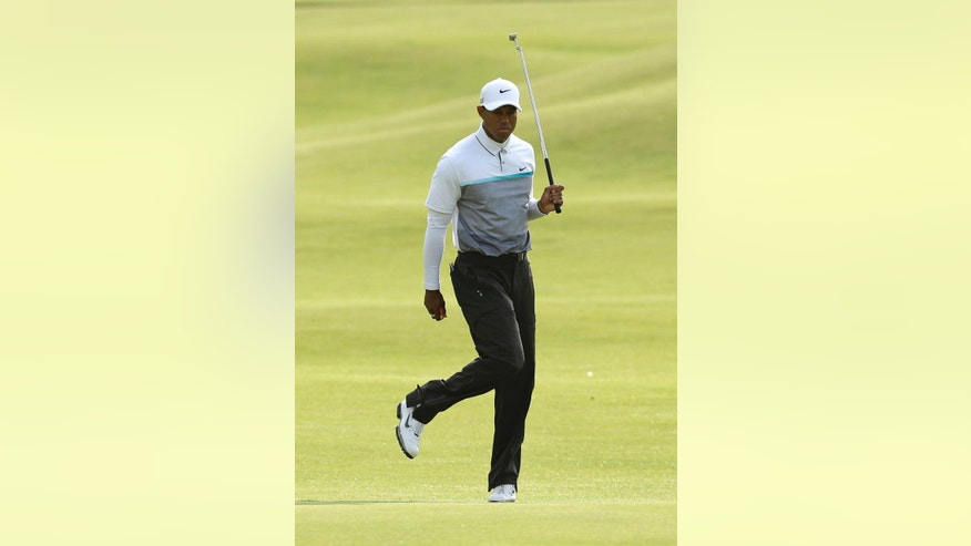 United States' Tiger Woods reacts as he putts to the 18th green during the second round of the British Open Golf Championship at the Old Course, St. Andrews, Scotland, Saturday, July 18, 2015. Woods failed to make the cut. (AP Photo/David J. Phillip)