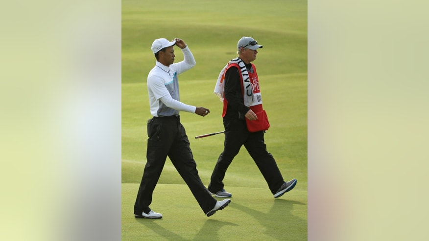 United States' Tiger Woods tips his cap as he walks onto the 18th green during the second round of the British Open Golf Championship at the Old Course, St. Andrews, Scotland, Saturday, July 18, 2015. (AP Photo/David J. Phillip)