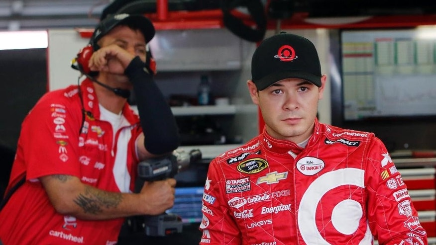 Kyle Larson leaves the garage area after the final practice before Sunday's NASCAR Sprint Cup series auto race at New Hampshire Motor Speedway Saturday, July 18, 2015, in Loudon, N.H. (AP Photo/Jim Cole)