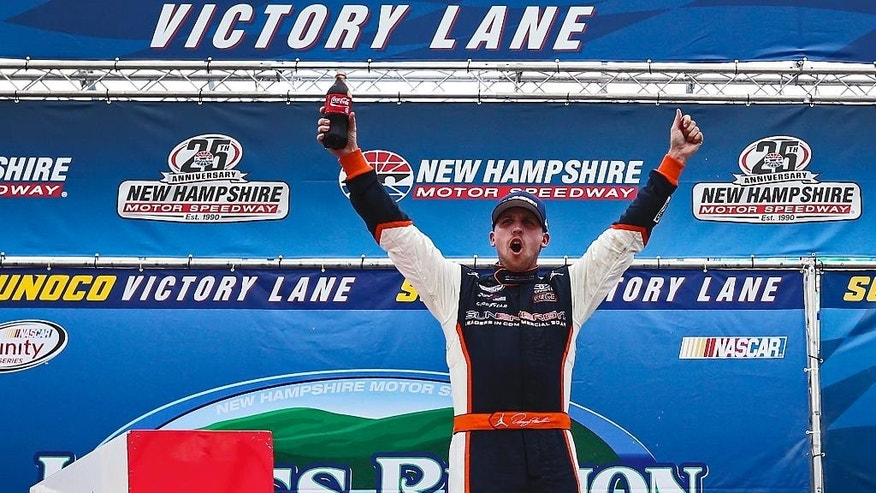 Denny Hamlin celebrates after winning the NASCAR Xfinity series auto race at New Hampshire Motor Speedway in Loudon, N.H., Saturday, July 18, 2015  (AP Photo/Cheryl Senter)