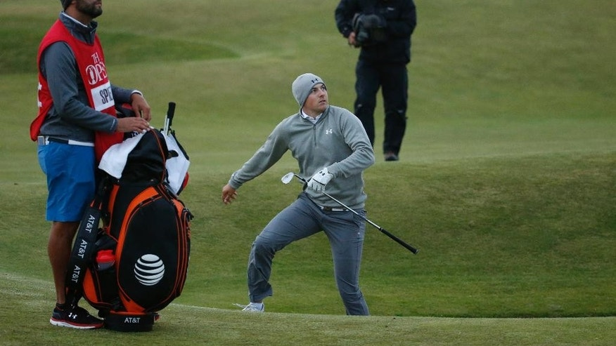 United States' Jordan Spieth follows his shot from a bunker on the 12th hole during the second round of the British Open Golf Championship at the Old Course, St. Andrews, Scotland, Friday, July 17, 2015. (AP Photo/Jon Super)