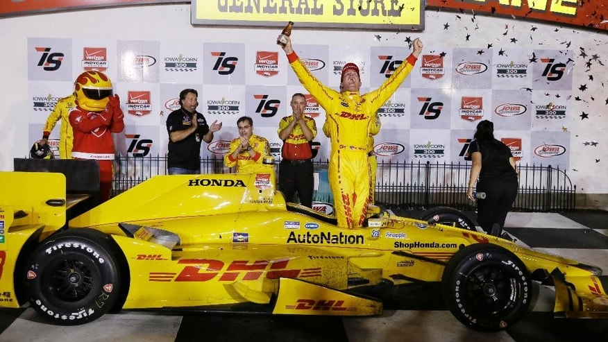 Ryan Hunter-Reay celebrates in Victory Lane after winning the IndyCar Series auto race Saturday, July 18, 2015, at Iowa Speedway in Newton, Iowa. (AP Photo/Charlie Neibergall)