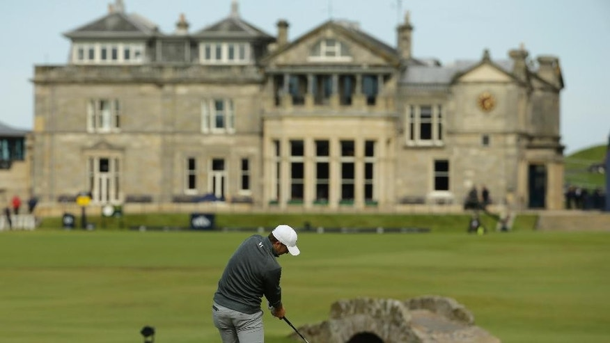 United States' Jordan Spieth drives the ball from the 18th tee during the third round of the British Open Golf Championship at the Old Course, St. Andrews, Scotland, Sunday, July 19, 2015. (AP Photo/David J. Phillip)