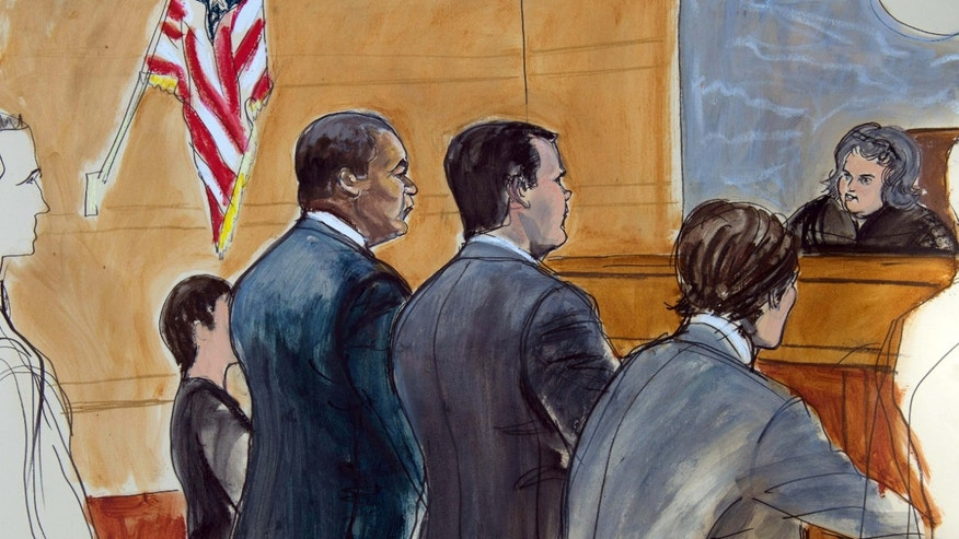 July 18, 2015: In this courtroom drawing, former FIFA official Jeffrey Webb, left, appears before United States Magistrate Judge Vera M. Scanlon, right, for arraignment on racketeering and bribery charges.