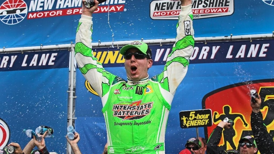 Kyle Busch celebrates in Victory Lane after winning the NASCAR Sprint Cup series auto race at New Hampshire Motor Speedway in Loudon, N.H., Sunday, July 19, 2015. (AP Photo/Cheryl Senter)