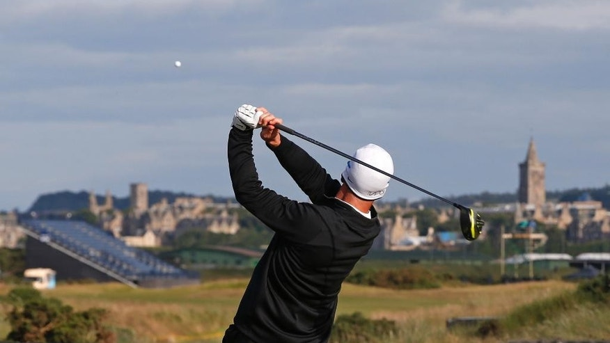 United States' David Duval lines up a putt on the 18th green during the third round at the British Open Golf Championship at the Old Course, St. Andrews, Scotland, Sunday, July 19, 2015. (AP Photo/Peter Morrison)
