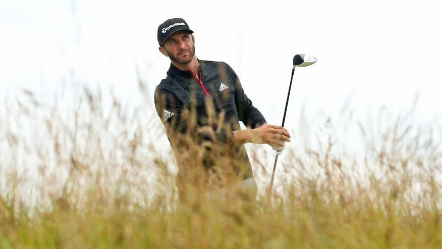 United States' Dustin Johnson plays from the seventh tee during the third round at the British Open Golf Championship at the Old Course, St. Andrews, Scotland, Sunday, July 19, 2015. (AP Photo/Peter Morrison)