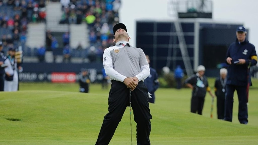 South Africa' Louis Oosthuizen reacts after missing a putt on the 17th during a playoff after the final round at the British Open Golf Championship at the Old Course, St. Andrews, Scotland, Monday, July 20, 2015. (AP Photo/David J. Phillip)
