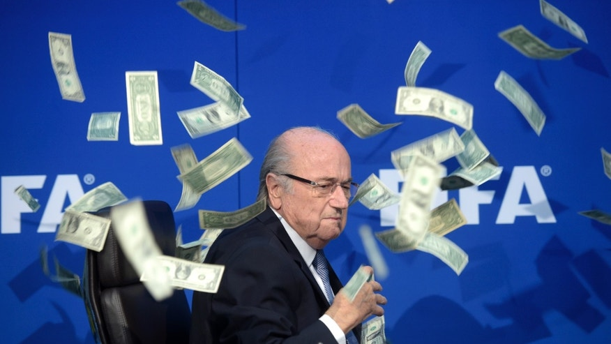 July 20, 2015 - FIFA president Sepp  Blatter amid banknotes thrown by British comedian Simon Brodkin during a press conference following the extraordinary FIFA Executive Committee at the  headquarters in Zurich, Switzerland.