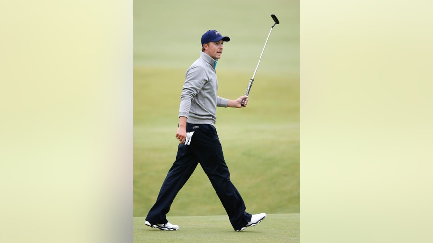 United States' Jordan Spieth gestures to spectators with his club after finishing the final round at the British Open Golf Championship at the Old Course, St. Andrews, Scotland, Monday, July 20, 2015. (AP Photo/Jon Super)