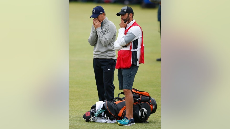 United States' Jordan Spieth, left, and his caddie Michael Greller after finishing the final round at the British Open Golf Championship at the Old Course, St. Andrews, Scotland, Monday, July 20, 2015. (AP Photo/Jon Super)