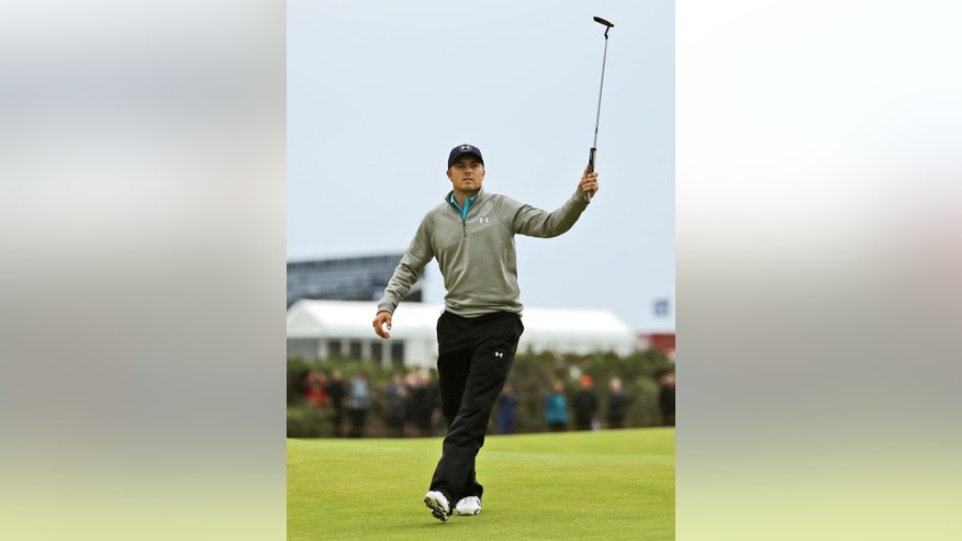 United States' Jordan Spieth birdies the 16th hole during the final round at the British Open Golf Championship at the Old Course, St. Andrews, Scotland, Monday, July 20, 2015. (AP Photo/David J. Phillip)