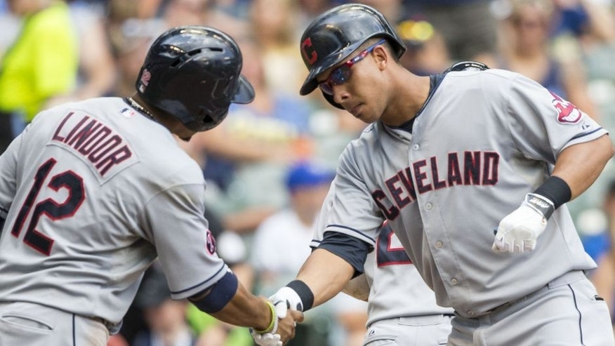 Cleveland Indians' Michael Brantley, right, shakes hands with teammate Francisco Lindor after hitting a three-run hom run off Milwaukee Brewers' Kyle Lohse during the third inning of a baseball game Wednesday, July 22, 2015, in Milwaukee.