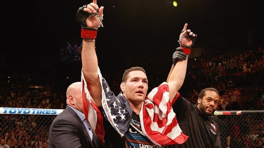 LAS VEGAS, NV - JULY 05: UFC middleweight champion Chris Weidman celebrates his win over Lyoto Machida in their UFC middleweight championship fight during the UFC 175 event at the Mandalay Bay Events Center on July 5, 2014 in Las Vegas, Nevada. (Photo by Donald Miralle/Zuffa LLC/Zuffa LLC via Getty Images) *** Local Caption *** Chris Weidman
