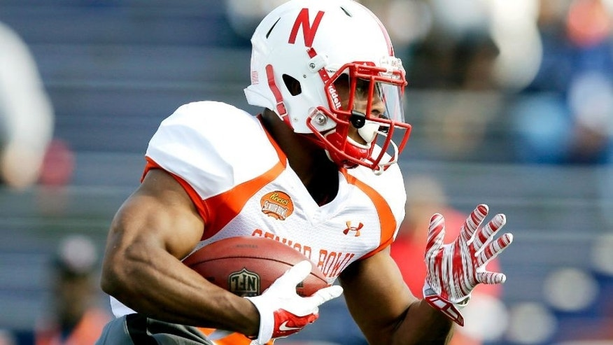 Nebraska running back Ameer Abdullah runs the ball during NCAA college football practice for the Senior Bowl, Tuesday, Jan. 20, 2015, at Ladd-Peebles Stadium in Mobile, Ala. (AP Photo/Brynn Anderson)