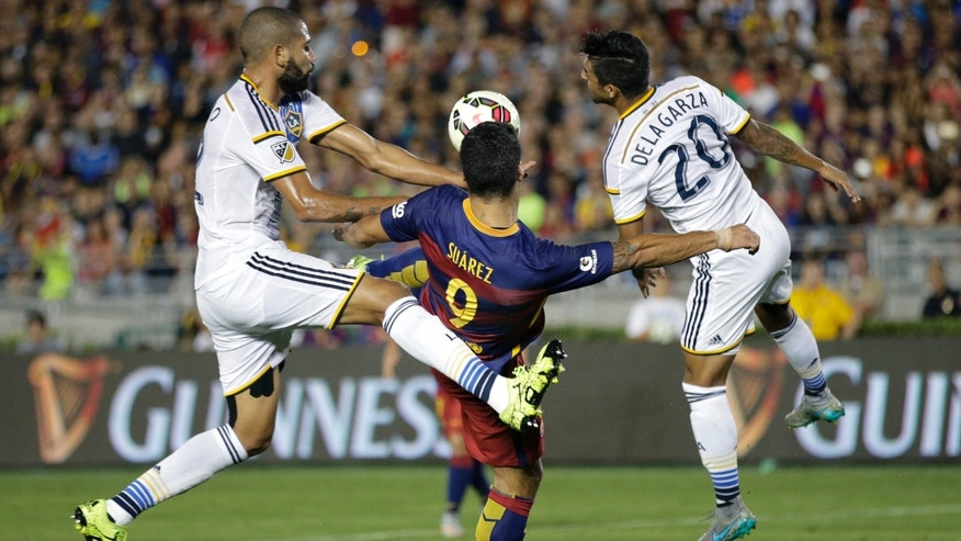 Luis Suarez, center, during the first half of an International Champions Cup soccer match, Tuesday, July 21, 2015.