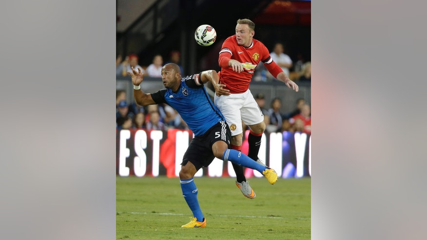 San Jose Earthquakes defender Victor Bernardez, left, and Manchester United forward Wayne Rooney, right, vie for the ball during the first half of an International Champions Cup soccer match Tuesday, July 21, 2015, in San Jose, Calif. (AP Photo/Eric Risberg)