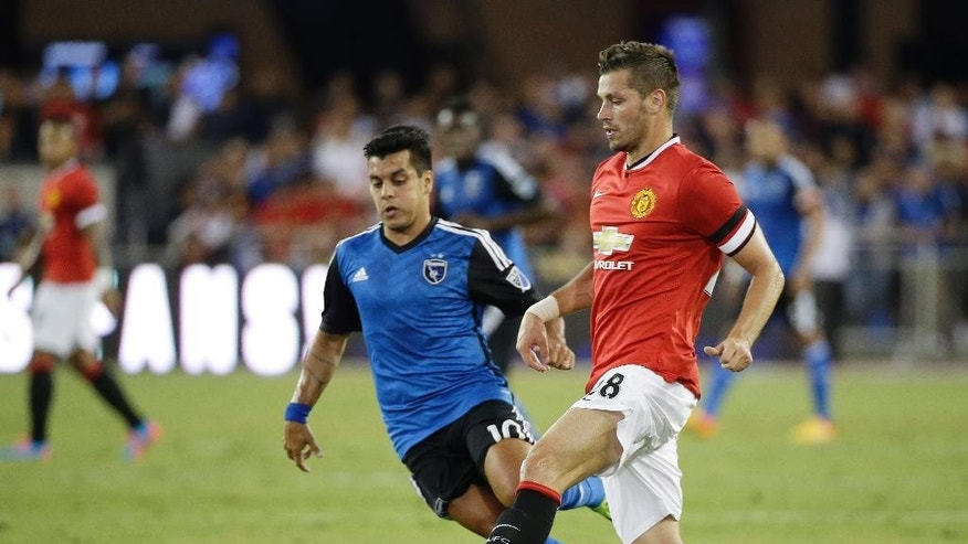 CORRECTS SPELLING TO SCHNEIDERLIN, INSTEAD OF SCHNIDERLEIN - Manchester United midfielder Morgan Schneiderlin, right, and San Jose Earthquakes midfielder Matias Perez Garcia vie for the ball during the first half of an International Champions Cup soccer match Tuesday, July 21, 2015, in San Jose, Calif. (AP Photo/Eric Risberg)
