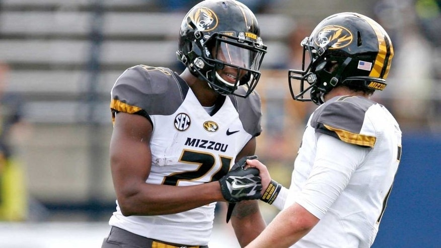 Sep 6, 2014; Toledo, OH, USA; Missouri Tigers wide receiver Bud Sasser (21) shakes hands with quarterback Maty Mauk (7) during the fourth quarter against the Toledo Rockets at Glass Bowl. Tigers beat the Rockets 49-24. Mandatory Credit: Raj Mehta-USA TODAY Sports
