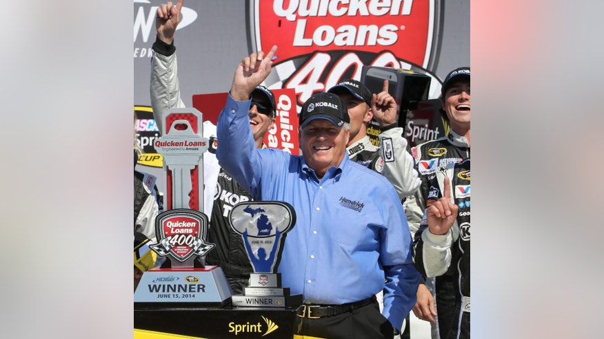 FILE - In this June 15, 2014, file photo, team owner Rick Hendrick celebrates in Victory Lane after Jimmie Johnson, not shown, won the NASCAR Quicken Loans 400 auto race at Michigan International Speedway in Brooklyn, Mich. One year after the Race Team Alliance was launched to much hype and curiosity, the owner's group is riding along without much fanfare. (AP Photo/Bob Brodbeck, File)