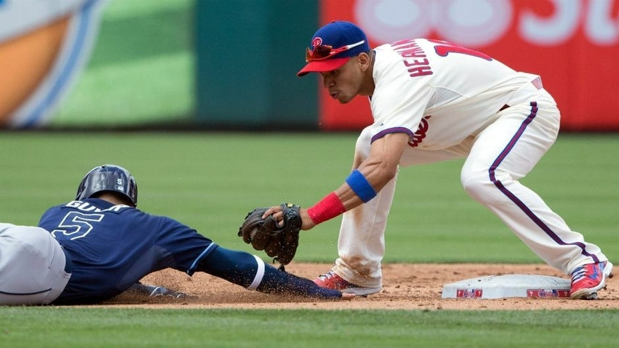 <p>Jul 22, 2015; Philadelphia, PA, USA; Philadelphia Phillies second baseman Cesar Hernandez (16) picks off Tampa Bay Rays left fielder Brandon Guyer (5) at second base during the third inning at Citizens Bank Park. Mandatory Credit: Bill Streicher-USA TODAY Sports</p>