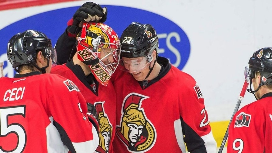 Oct 16, 2014; Ottawa, Ontario, CAN; Ottawa Senators goalie Craig Anderson (41) is congratulated by center Curtis Lazar (27) following their win against the Colorado Avalanche at the Canadian Tire Centre. The Senators defeated the Colorado Avalanche 5-3. Mandatory Credit: Marc DesRosiers-USA TODAY Sports