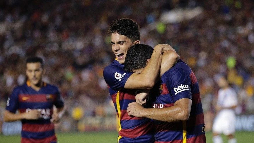 FC Barcelona's Luis Suarez, right, celebrates his goal with Marc Bartra during the first half of an International Champions Cup soccer match, Tuesday, July 21, 2015, in Pasadena, Calif. (AP Photo/Jae C. Hong)