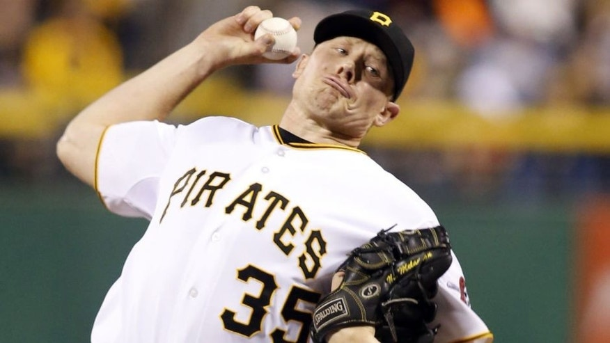 Sep 18, 2014; Pittsburgh, PA, USA; Pittsburgh Pirates relief pitcher Mark Melancon (35) pitches against the Boston Red Sox during the ninth inning at PNC Park. The Pirates won 3-2. Mandatory Credit: Charles LeClaire-USA TODAY Sports