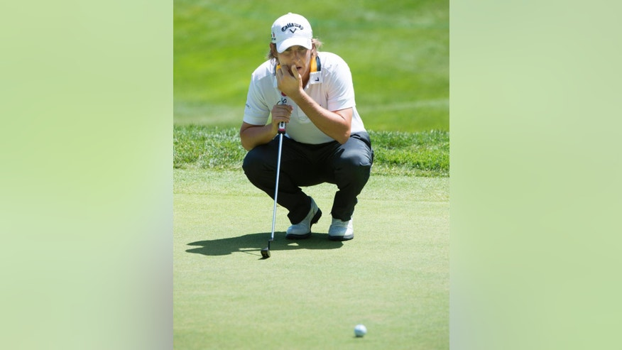Emiliano Grillo from Argentina lines up his putt on the 9th green during first round of play at the Canadian Open golf tournament Thursday, July 23, 2015,  in Oakville, Ontario. (Paul Chiasson/The Canadian Press via AP)