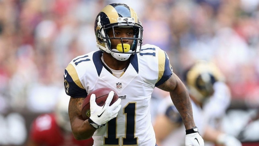 GLENDALE, AZ - DECEMBER 08: Wide receiver Tavon Austin #11 of the St. Louis Rams runs with the football during the NFL game against the Arizona Cardinals at the University of Phoenix Stadium on December 8, 2013 in Glendale, Arizona. The Cardinals defeated the Rams 30-10. (Photo by Christian Petersen/Getty Images) *** Local Caption *** Tavon Austin