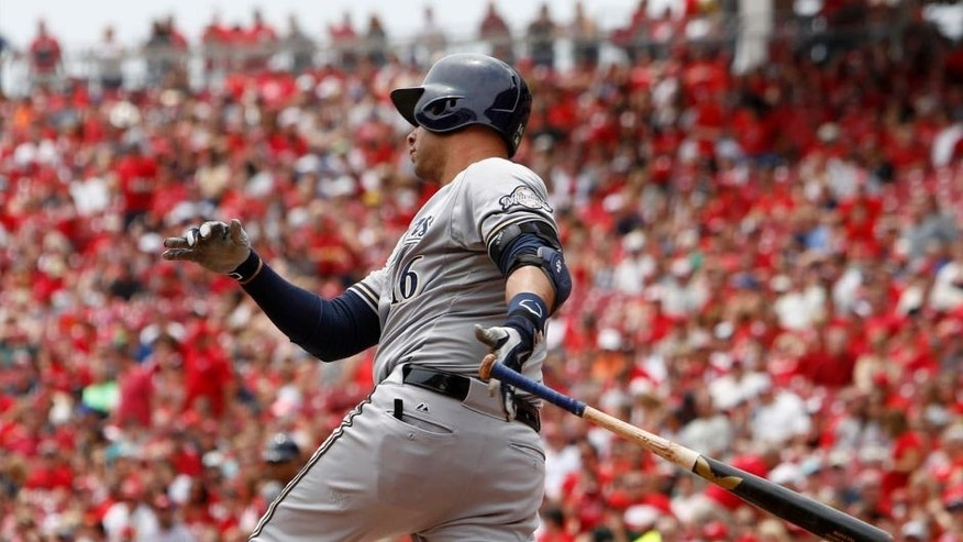 Sunday, July 5: Milwaukee Brewers third baseman Aramis Ramirez hits a RBI single off Cincinnati Reds starting pitcher Mike Leake in the first inning at Great American Ball Park.