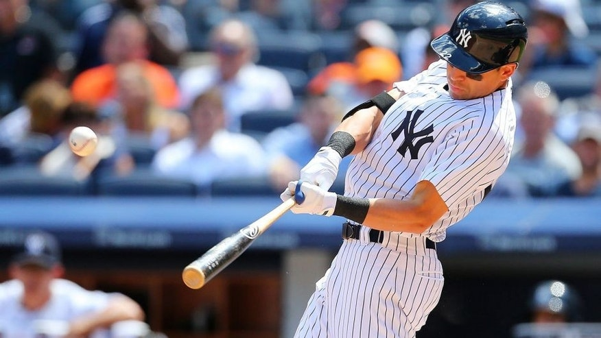 NEW YORK, NY - JULY 23: Jacoby Ellsbury #22 of the New York Yankees hits a two run double in the fifth inning against the Baltimore Orioles at Yankee Stadium on July 23, 2015 in the Bronx borough of New York City. (Photo by Mike Stobe/Getty Images)