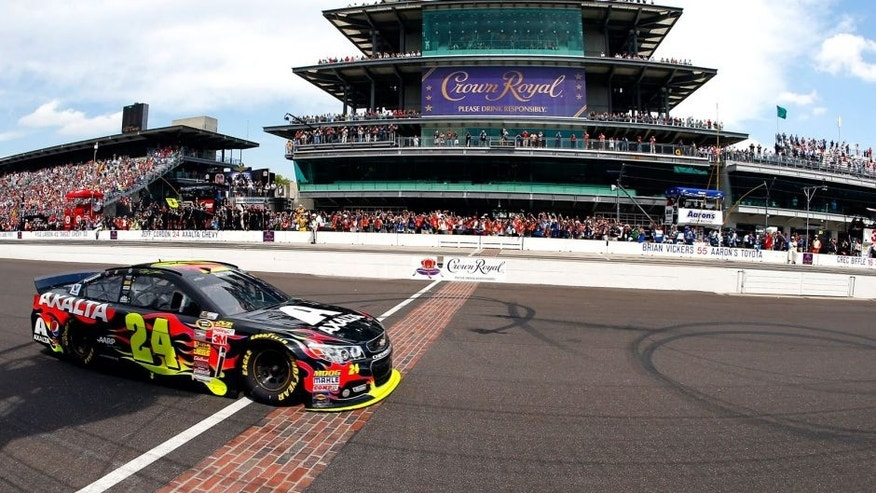 INDIANAPOLIS, IN - JULY 27: Jeff Gordon, driver of the #24 Axalta Chevrolet, takes the checkered flag to win the NASCAR Sprint Cup Series Crown Royal Presents The John Wayne Walding 400 at the Brickyard Indianapolis Motor Speedway on July 27, 2014 in Indianapolis, Indiana. (Photo by Matt Sullivan/Getty Images)