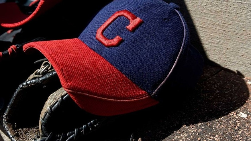 Mar 12, 2011; Goodyear, AZ, USA; A detailed view of a Cleveland Indians hat and glove during a game against the Los Angeles Angels at Goodyear Ballpark. Mandatory Credit: Jake Roth-USA TODAY Sports