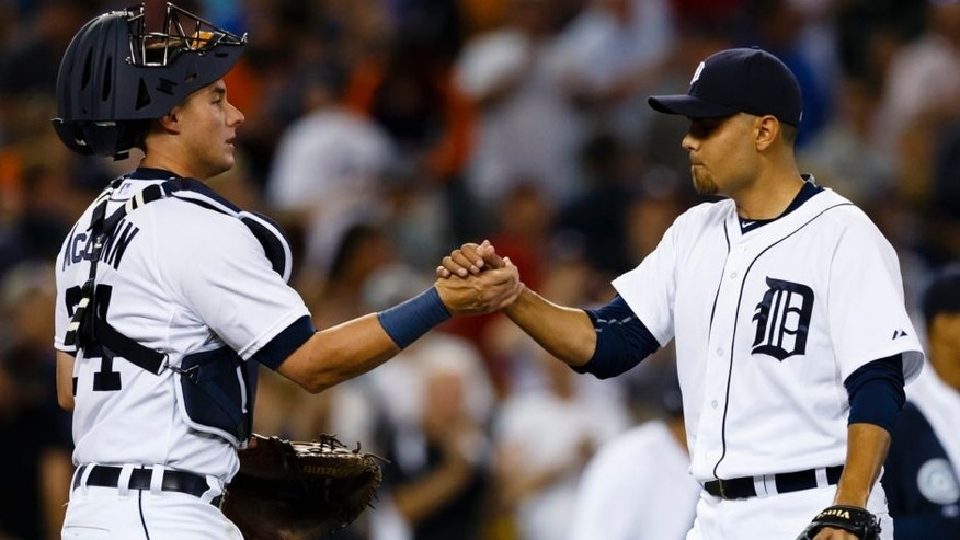 Jul 22, 2015; Detroit, MI, USA; Detroit Tigers first baseman Miguel Cabrera (24) and relief pitcher Joakim Soria (38) celebrate after their game against the Seattle Mariners at Comerica Park. The Tigers won 9-4. Mandatory Credit: Rick Osentoski-USA TODAY Sports