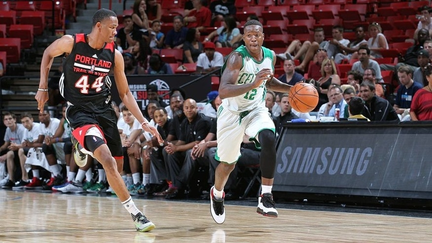 LAS VEGAS, NV - JULY 16: Terry Rozier #12 of the Boston Celtics drives to the basket against the Portland Trail Blazers during the game on July 16, 2015 at Thomas And Mack Center, Las Vegas, Nevada. NOTE TO USER: User expressly acknowledges and agrees that, by downloading and or using this Photograph, user is consenting to the terms and conditions of the Getty Images License Agreement. Mandatory Copyright Notice: Copyright 2015 NBAE (Photo by Jack Arent/NBAE via Getty Images)